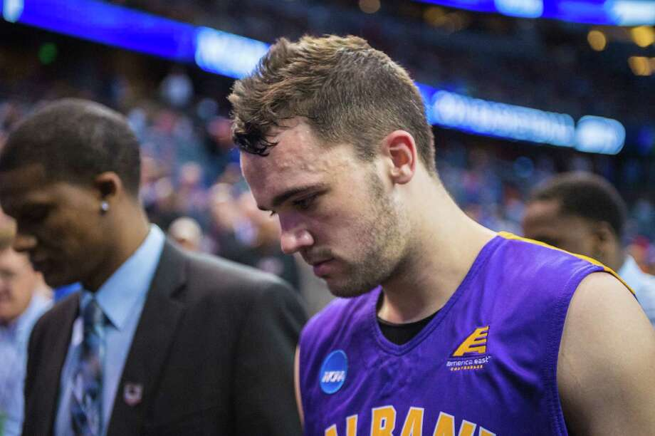 UAlbany Great Danes guard Peter Hooley (12) walks off the court after NCAA second round game against the Florida Gators, Thurday afternoon, March 20, 2014, in Orlando, FLA. (Gregory Fisher/Special to the Times Union) Photo: GF / SportsThroughTheLens.com