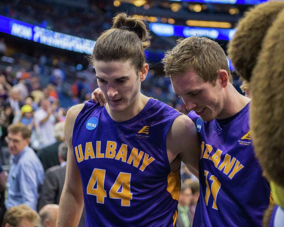 UAlbany Great Danes center John Puk (44) and UAlbany Great Danes forward Luke Devlin (11) leave the court after their NCAA second round game against the Florida Gators, Thurday afternoon, March 20, 2014, in Orlando, FLA. (Gregory Fisher/Special to the Times Union) Photo: GF / SportsThroughTheLens.com