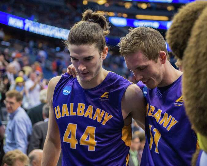 UAlbany Great Danes center John Puk (44) and UAlbany Great Danes forward Luke Devlin (11) leave the