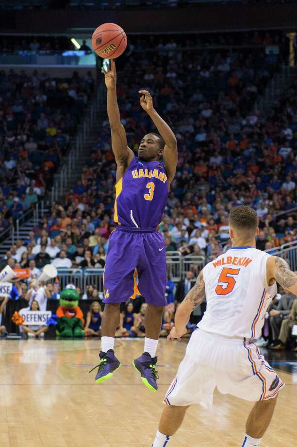 UAlbany Great Danes guard DJ Evans (3) puts up a 3 point shot against the Florida Gators during the NCAA second round game, Thurday afternoon, March 20, 2014, in Orlando, FLA. (Gregory Fisher/Special to the Times Union) Photo: GF / SportsThroughTheLens.com