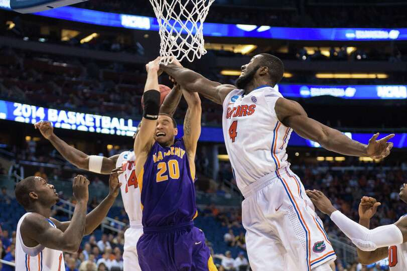 UAlbany Great Danes forward Gary Johnson (20) has the ball knocked away going up for a shot by Flori