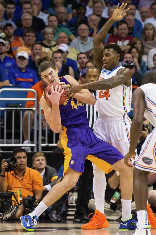 UAlbany Great Danes center John Puk (44) grabs the rebound with Florida Gators forward Casey Prather (24) defending during the first half of the NCAA second round game, Thurday afternoon, March 20, 2014, in Orlando, FLA. (Gregory Fisher/Special to the Times Union) Photo: GF / SportsThroughTheLens.com