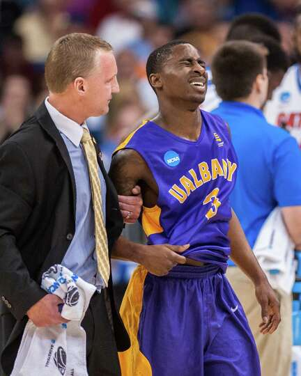 UAlbany Great Danes guard DJ Evans (3) is helped off the court after getting kicked in the second ha