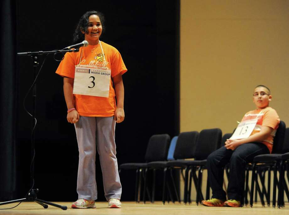 Anika Malayappan, of Danbury, smiles after defeating Abram Goda, of Bridgeport, in the final spell-off at the Hearst Media Services Regional Spelling Bee at Western Connecticut State University in Danbury, Conn. Thursday, March 20, 2014. Photo: Tyler Sizemore / The News-Times