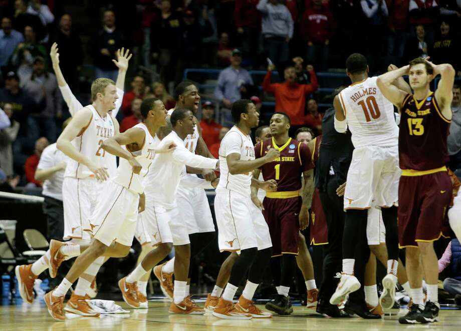 MILWAUKEE, WI - MARCH 20:  The Texas Longhorns celebrate their 87 to 85 win over the Arizona State Sun Devils in the second round of the 2014 NCAA Men's Basketball Tournament at BMO Harris Bradley Center on March 20, 2014 in Milwaukee, Wisconsin. Photo: Mike McGinnis, Getty Images / 2014 Getty Images