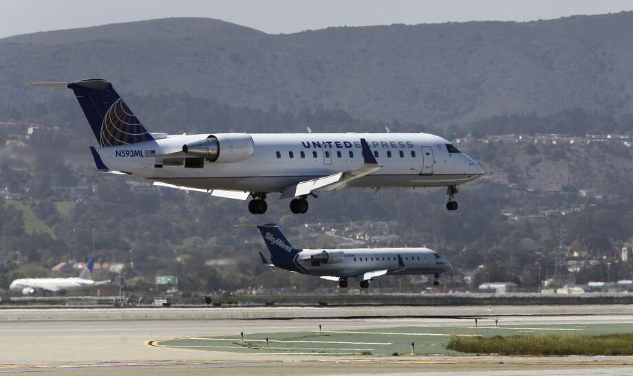 FILE — Regional commuter jets land on parallel runways 28L and 28R at San Francisco International Airport in San Francisco, Calif. on Thursday, March 20, 2014. SFO will be shutting down Runway 28L for 20 days in September to reconstruct the base layer. Photo: Paul Chinn, The Chronicle