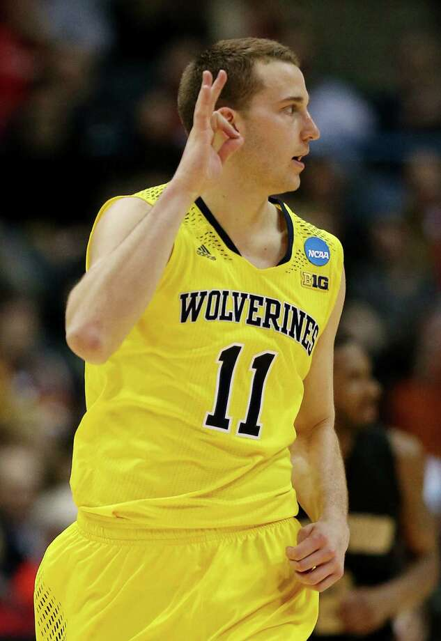 Michigan's Nik Stauskas gestures after making a 3-pointer during the Wolverines' second-round victory over Wofford. Photo: Jonathan Daniel / Getty Images / 2014 Getty Images