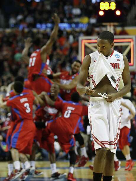 Ohio State forward Sam Thompson, who led the sixth-seeded Buckeyes with 18 points, shows his dismay as the 11th-seeded Dayton Flyers rejoice over their upset victory in Buffalo, N.Y. Photo: McClatchy-Tribune News Service / Columbus Dispatch