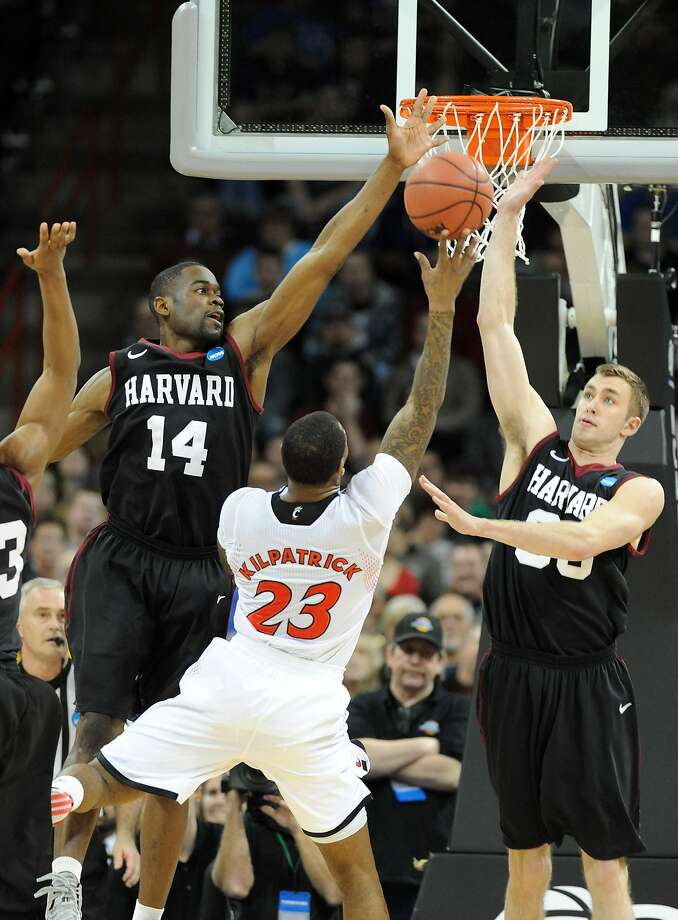 Cincinnati's Sean Kilpatrick tries to get his shot up against Steve Moundou-Missi (left) and Evan Cummins of Harvard. Photo: Steve Dykes, Getty Images