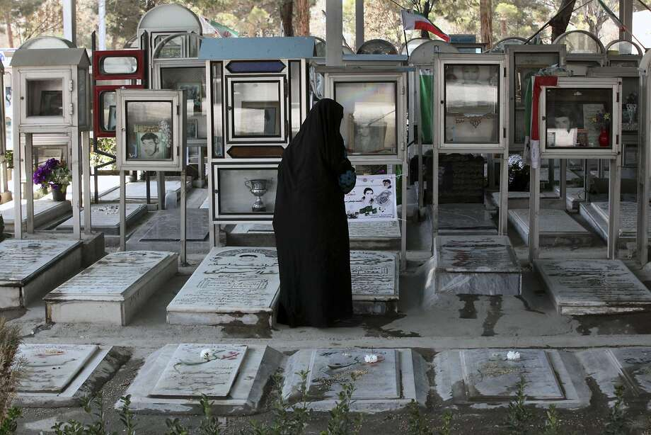 "An elderly Iranian woman looks at the graves of soldiers who were killed during 1980-88 Iran-Iraq war, at the Behesht-e-Zahra cemetery just outside Tehran, Iran, Thursday, Macrch 20, 2104, on the eve of the Iranian New Year, or Nowruz. Nowruz which means ""New Day"" in Persian, marks the first day of spring and the beginning of the year on the Iranian calendar, which occurs exactly on the Spring Equinox, and usually begins on March 21 or the previous or following day. (AP Photo/Vahid Salemi) Photo: Vahid Salemi, Associated Press"