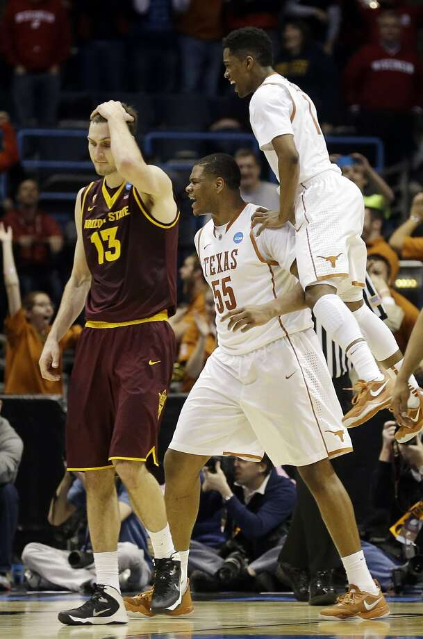 Texas' Cameron Ridley (No. 55) relishes his game-winning shot. Photo: Jeffrey Phelps, Associated Press