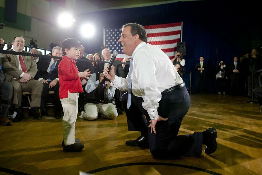 New Jersey Gov. Chris Christie meets with Samuel Kang, 3, during a town hall-style meeting, Thursday, March 20, 2014, at St. Magdalen de Pazzi parish center in Flemington, N.J.  Christie says his signature town hall meetings help keep him in tune with what average citizens are thinking. (AP Photo/Matt Rourke) Photo: Matt Rourke, Associated Press