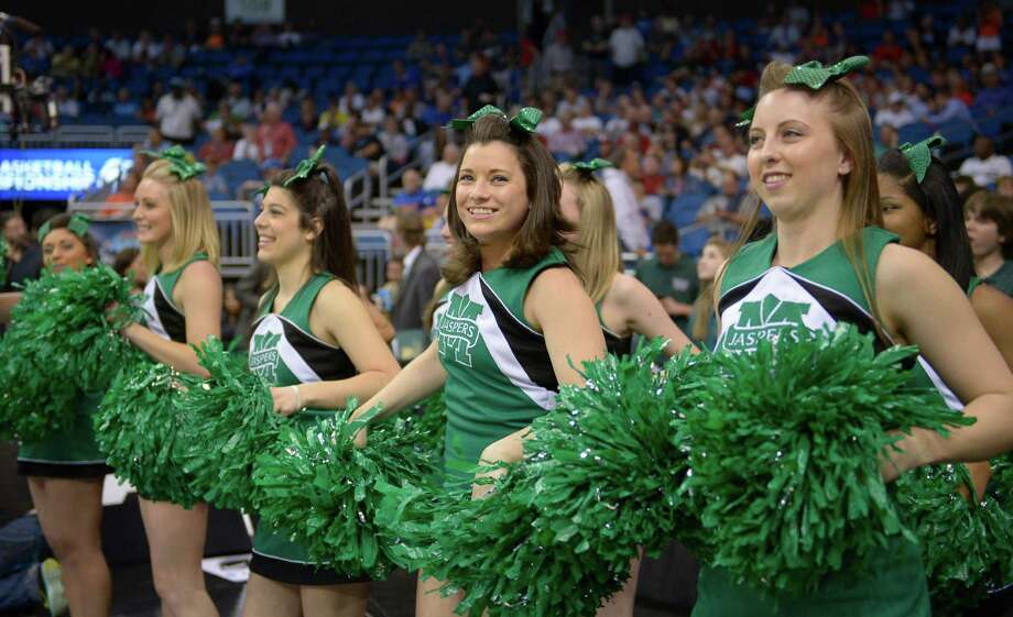 Manhattan cheerleaders perform during the first half against Louisville, in a second-round game in the NCAA college basketball tournament Thursday, March 20, 2014, in Orlando, Fla. Saint Louis defeated North Carolina State 83-80 in overtime. (AP Photo/Phelan M. Ebenhack) Photo: Phelan M. Ebenhack, Associated Press / FR121174 AP