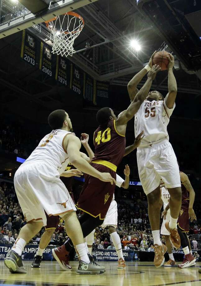Texas's Cameron Ridley (55) goes up for the game-winning shot Thursday over Arizona State's Shaquielle McKissic. Ridley finished with 17 points, 12 rebounds and four blocks. Photo: Morry Gash / Associated Press / AP