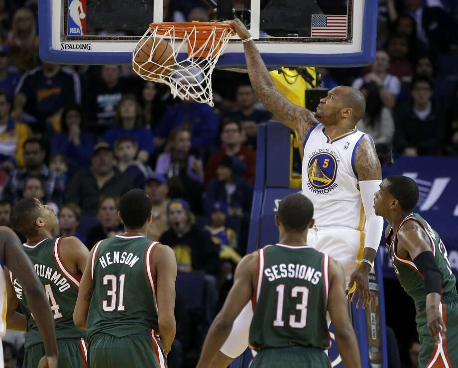 Golden State Warriors' Marreese Speights (5) scores as Milwaukee Bucks, from left, Giannis Antetokounmpo, John Henson (31), Ramon Sessions, and Khris Middleton watch during the first half of an NBA basketball game Thursday, March 20, 2014, in Oakland, Calif. (AP Photo/Ben Margot) Photo: Ben Margot, Associated Press
