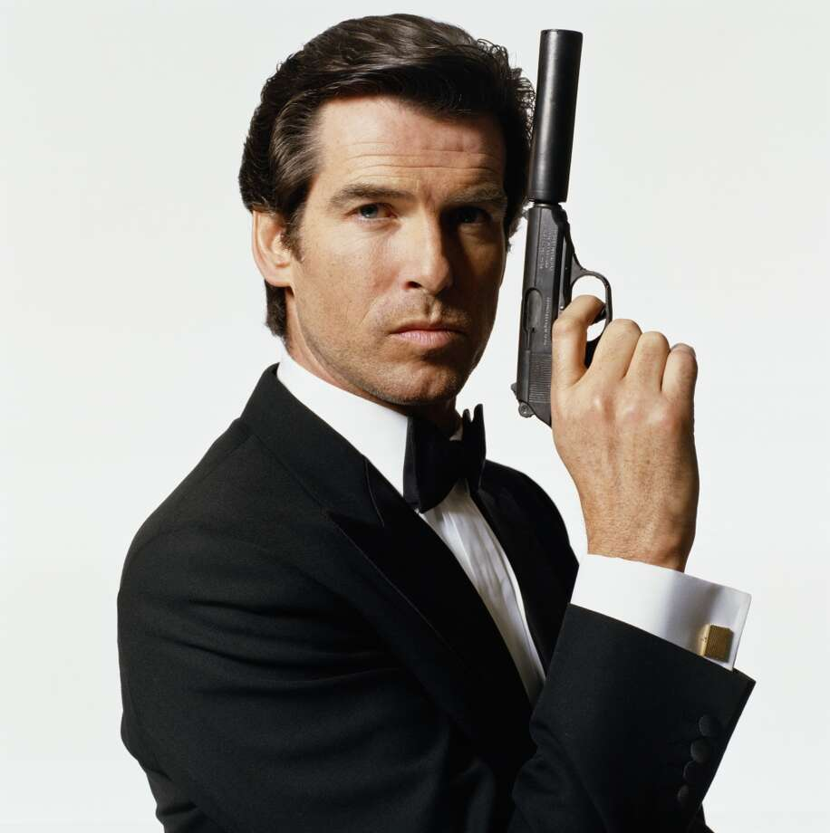 "Irish actor Pierce Brosnan took over the James Bond role in the late 1990s. He ultimately appeared in four films starting with 1995's ""GoldenEye."" A restrained, Armani-like elegance marked the Bronson period. Photo: Terry O'Neill, Getty Images"