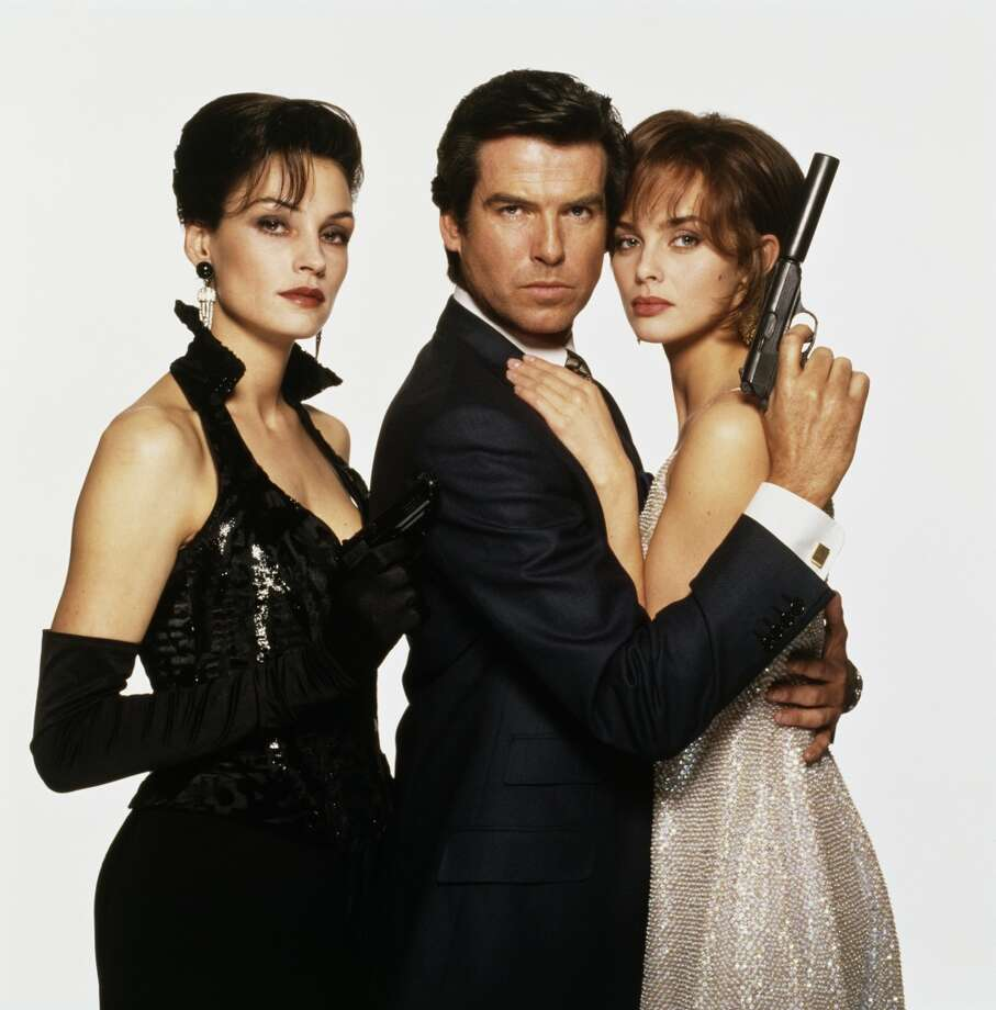 "Pierce Brosnan as James Bond, with his ""GoldenEye"" co-stars Famke Janssen (left) and Izabella Scorupco. Photo: Terry O'Neill, Getty Images"