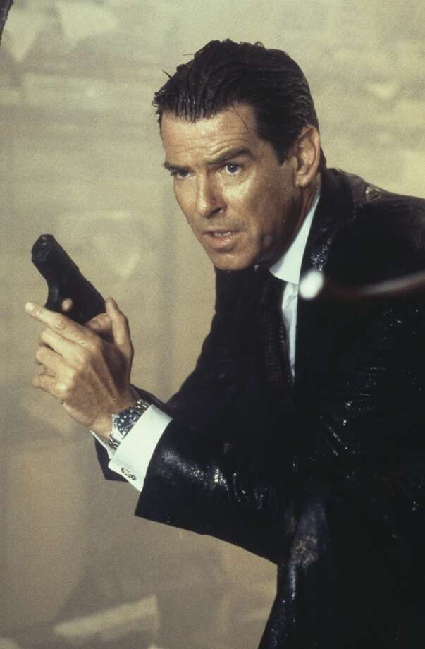 "Pierce Brosnan armed with his Walther P99, in a scene from the James Bond film ""The World Is Not Enough"" in 1999. Even soaking wet the man knows how to wear a suit. Photo: Keith Hamshere, Getty Images"