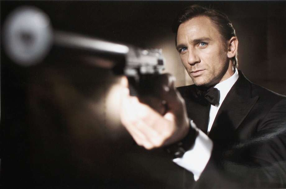 "Actor Daniel Craig poses as James Bond. Craig was unveiled as legendary British secret agent James Bond 007 in the 21st Bond film, ""Casino Royale"" in 2005. Though some protested a blond Bond, Craig has since gained many fans for his portrayal of the well-known agent. Craig's rugged looks and Tom Ford tailoring leave this fashion writer sartorially shaken and stirred. Photo: Greg Williams, Getty Images"