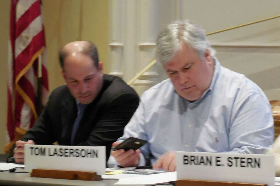 Board of Finance members (from left) Lee Caney and Tom Lasersohn look over budget figures during a workshop where the Board of Education budget was approved Thursday night. Photo: Anne M. Amato / westport news