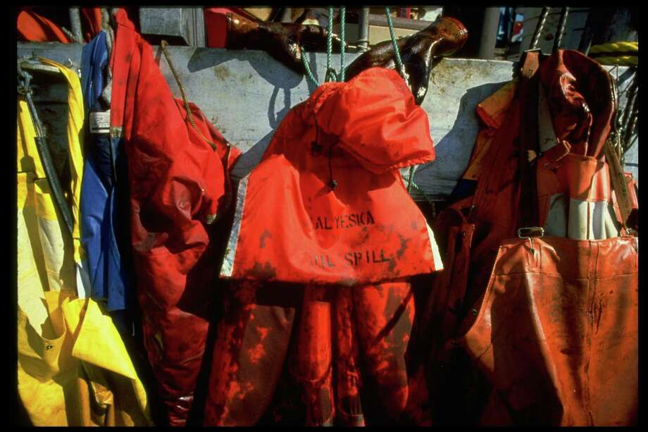 Oil soiled cleanup workers' garments hanging on pegs in aftermath of Exxon Valdez oil spill. Photo: Alan Levenson, Time & Life Pictures/Getty Image / Alan Levenson