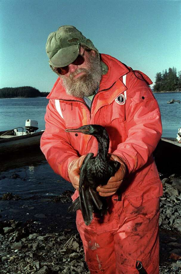 Fisherman John Thomas carries an oil-soaked sea bird at the bird rescue center in Valdez, more a week after the beginning of an oil disaster which occurred when the tanker Exxon Valdez ran aground and spilled 11 million gallons of crude oil into Prince William Sound off Alaska. Photo: CHRIS WILKINS, AFP/Getty Images / AFP