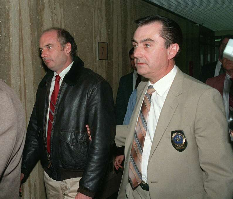 Former captain Joseph Hazelwood of the tanker Exxon Valdez, owned by US petroleum giant Exxon Corporation, is escorted by police official to his arraignment inside Suffolk County courthouse on charges stemming from the Alaskan oil disaster. Photo: BILL SWERSEY, AFP/Getty Images / 2013 AFP