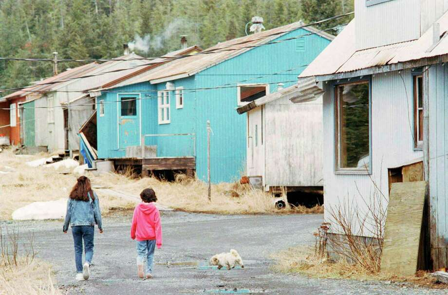 Two unidentified children walk through the village of Tatitlek, May 17, 1989, Tatitlek, Alaska. Life in this fishing village is uncertain since the Exxon Valdez hemorrhaged more than 10 million gallons of crude oil just 5 miles from their cove. Though local folks have seen little of the oil in their waters, the oil spill has jeopardized the fishing season, on which the village depends. Photo: JOHN GAPS III, ASSOCIATED PRESS / AP1989