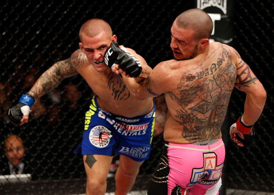 LONDON, ENGLAND - FEBRUARY 16:  (L-R) Dustin Poirier punches Cub Swanson in their featherweight fight during the UFC on Fuel TV event on February 16, 2013 at Wembley Arena in London, England. Photo: Josh Hedges/Zuffa LLC, Getty Images / 2013 Josh Hedges/Zuffa LLC