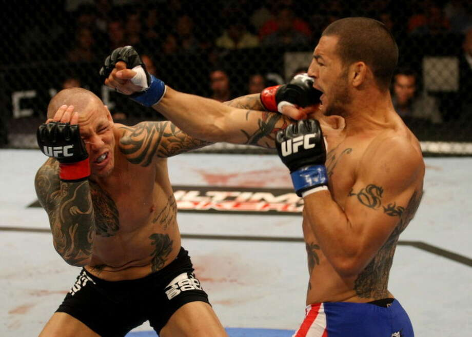 ATLANTIC CITY, NJ - JUNE 22:  (L-R) Ross Pearson and Cub Swanson exchange punches in a featherweight bout during UFC on FX 4 at Revel Casino on June 22, 2012 in Atlantic City, New Jersey.  (Photo by Nick Laham/Zuffa LLC/Zuffa LLC) Photo: Nick Laham/Zuffa LLC, Getty Images / 2012 Nick Laham/Zuffa LLC