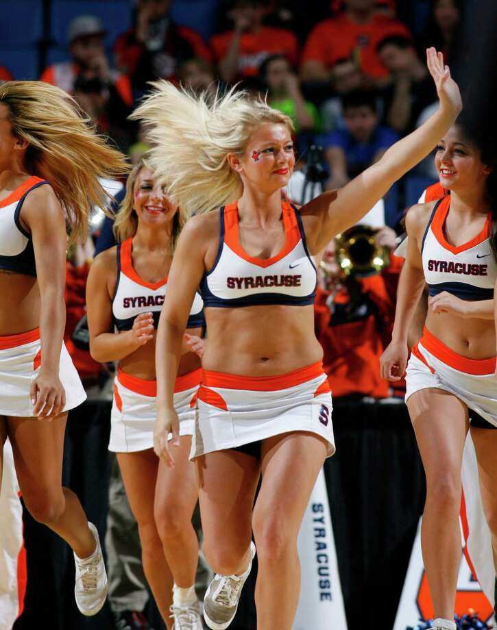 Syracuse cheerleaders entertain during the second half of a second-round game against Western Michigan in the NCAA college basketball tournament in Buffalo, N.Y., Thursday, March 20, 2014. (AP Photo/Bill Wippert) Photo: Bill Wippert, Associated Press / FR170745 AP