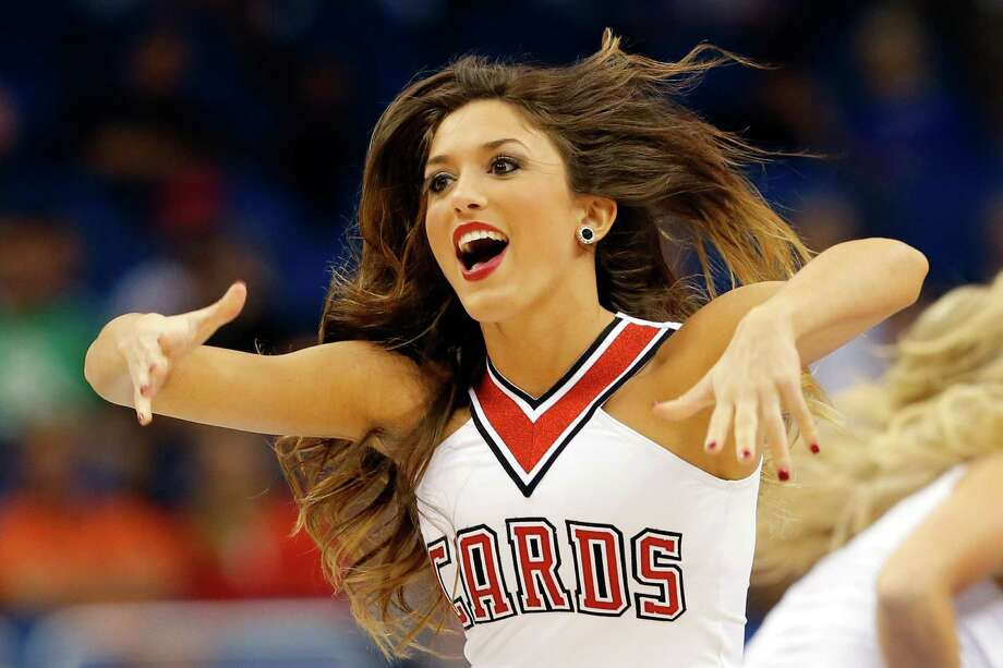 ORLANDO, FL - MARCH 20:  A Louisville Cardinals cheerleader performs during the second round of the 2014 NCAA Men's Basketball Tournament at Amway Center on March 20, 2014 in Orlando, Florida. Photo: Kevin C. Cox, Getty Images / 2014 Getty Images