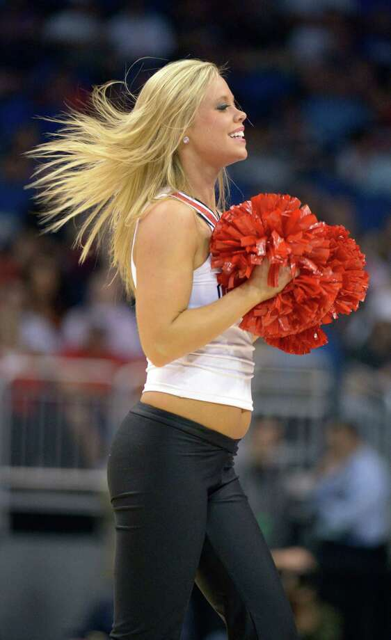 A Louisville cheerleader performs during the first half against in Manhattan, in a second-round game in the NCAA college basketball tournament Thursday, March 20, 2014, in Orlando, Fla. (AP Photo/Phelan M. Ebenhack) Photo: Phelan M. Ebenhack, Associated Press / FR121174 AP