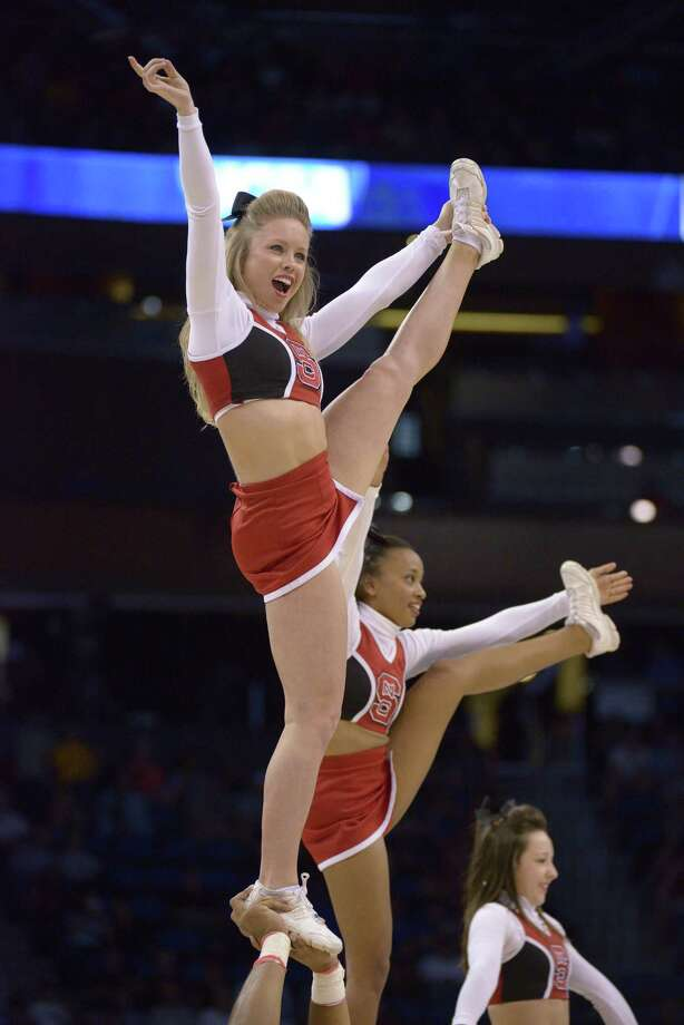 North Carolina State cheerleaders perform during the first half agains Saint Louis, in a second-round game in the NCAA college basketball tournament Thursday, March 20, 2014, in Orlando, Fla. (AP Photo/Phelan M. Ebenhack) Photo: Phelan M. Ebenhack, Associated Press / FR121174 AP