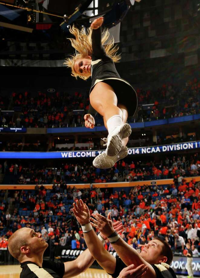 A Western Michigan cheerleader entertains during the second half of a second-round game against Syracuse in the NCAA college basketball tournament in Buffalo, N.Y., Thursday, March 20, 2014. (AP Photo/Bill Wippert) Photo: Bill Wippert, Associated Press / FR170745 AP
