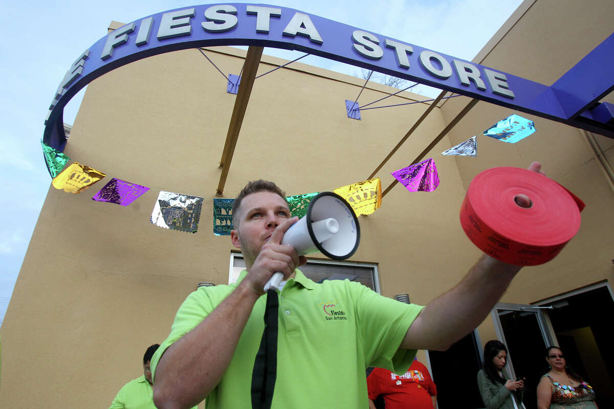 Nick Kaylor, Director of Operations for the Fiesta Commission, explains to people Friday March 21, 2014 how tickets to Fiesta events can obtained at the Fiesta Store on Broadway. Tickets to 19 Fiesta events are available through a process of random numbers being drawn and some event tickets are also available at area retail outlets.Tickets to events can also be obtained online.