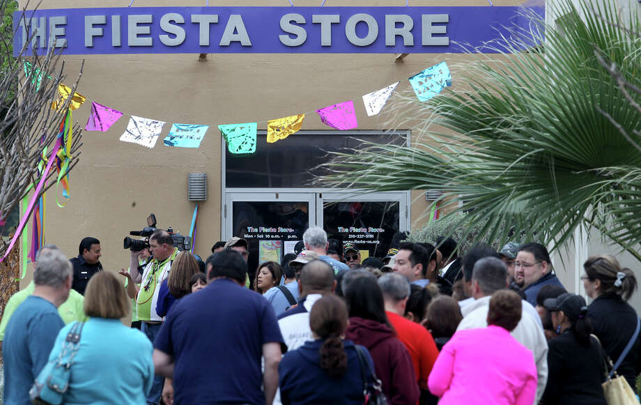 People wait in line Friday March 21, 2014 to get tickets to Fiesta events at the Fiesta Store on Broadway. Tickets to 19 Fiesta events are available through a process of random numbers being drawn and some event tickets are also available at area retail outlets.Tickets to events can also be obtained online. Photo: JOHN DAVENPORT, SAN ANTONIO EXPRESS-NEWS / ©San Antonio Express-News/Photo may be sold to the public
