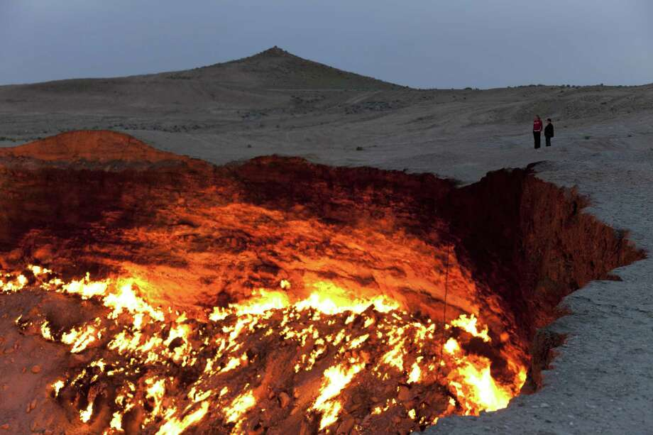 A crazy natural-gas-fueled crater has been burning since 1971 when it was lit by Soviet scientists trying to figure out what to do with a giant gas leak. They thought it would burn out. Photo: (c) Flydime, Getty Images/Flickr RF / Flickr RF