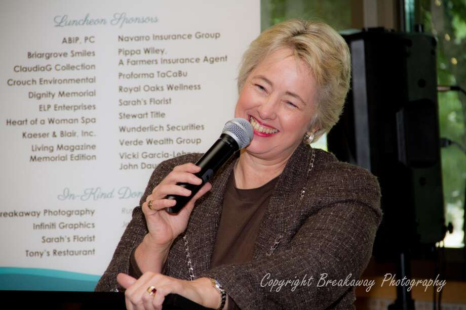 Mayor Annise Parker laughs with the Women of Excellence in Business on March 19, 2014 Photo: Rusty Salazar