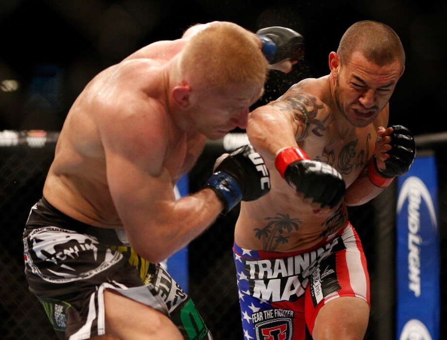 LAS VEGAS, NV - JULY 06:  (R-L) Cub Swanson punches Dennis Siver in their featherweight fight during the UFC 162 event inside the MGM Grand Garden Arena on July 6, 2013 in Las Vegas, Nevada. Photo: Josh Hedges/Zuffa LLC, Getty Images / 2013 Josh Hedges/Zuffa LLC