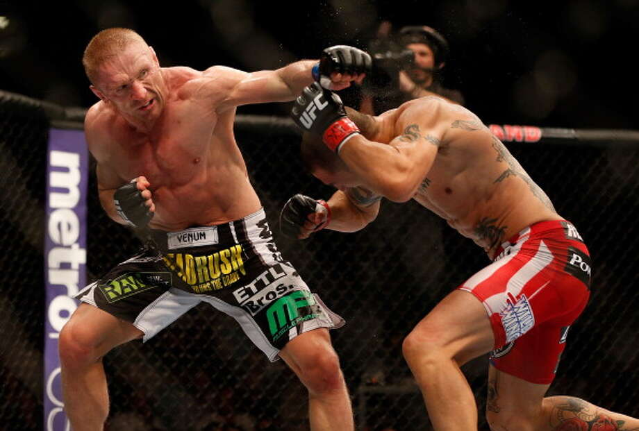 LAS VEGAS, NV - JULY 06:  (L-R) Dennis Siver punches Cub Swanson in their featherweight fight during the UFC 162 event inside the MGM Grand Garden Arena on July 6, 2013 in Las Vegas, Nevada. Photo: Josh Hedges/Zuffa LLC, Getty Images / 2013 Josh Hedges/Zuffa LLC
