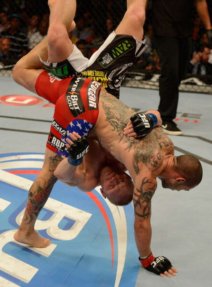 LAS VEGAS, NV - JULY 06:  Cub Swanson (red shorts) slams Dennis Siver in their featherweight fight during the UFC 162 event inside the MGM Grand Garden Arena on July 6, 2013 in Las Vegas, Nevada. Photo: Donald Miralle/Zuffa LLC, Getty Images / 2013 Donald Miralle/Zuffa LLC