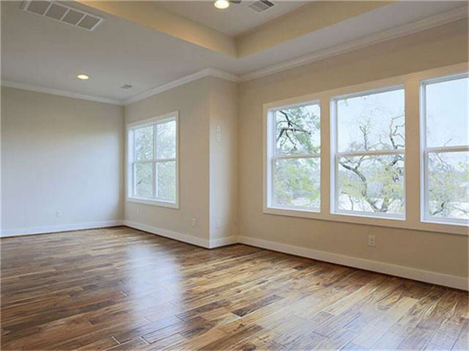 1049 W 17th: This 2014 home has 3 bedrooms, 3.5 bathrooms, and 2,412 square feet. Listed for $412,268. Open house: 3/23/2014, 1 p.m. to 5 p.m. Photo: Houston Association Of Realtors