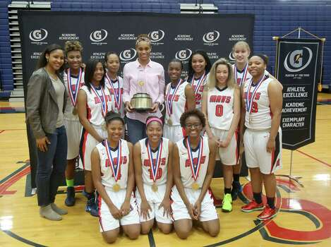 3/20/14: Brianna Turner poses with WNBA player Maya Moore, her and her teammates. Manvel's Brianna Turner was  named the 2013-14 Gatorade National Girls Basketball Player of the Year. at Manvel High School in Alvin, TX.  Presenting the award was 2006-07 player of the year Maya Moore, who plays in the WNBA. and Aminah Charles from Gatorade. Photo: Thomas B. Shea, Houston Chroncile / © 2014 Thomas B. Shea