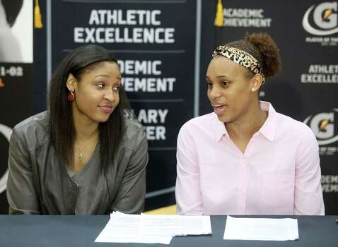 3/20/14: WNBA player maya Noore talks with Brianna Turner before the ceremony. Manvel's Brianna Turner was  named the 2013-14 Gatorade National Girls Basketball Player of the Year. at Manvel High School in Alvin, TX.  Presenting the award was 2006-07 player of the year Maya Moore, who plays in the WNBA. and Aminah Charles from Gatorade. Photo: Thomas B. Shea, Houston Chroncile / © 2014 Thomas B. Shea