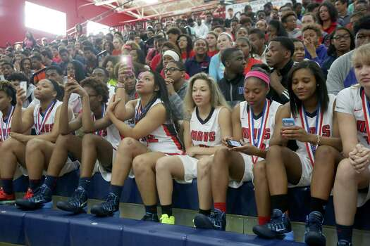 3/20/14: Chantry Carter #21 and teammates video tape the 2013-14 Gatorade National Girls Basketball Player of the Year ceremony. Manvel's Brianna Turner was  named the 2013-14 Gatorade National Girls Basketball Player of the Year at Manvel High School in Alvin, TX.  Presenting the award was 2006-07 player of the year Maya Moore, who plays in the WNBA. and Aminah Charles from Gatorade. Photo: Thomas B. Shea, Houston Chroncile / © 2014 Thomas B. Shea