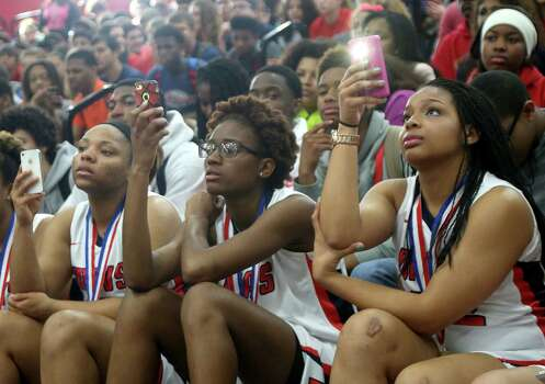 3/20/14: From left to right Jonee Jones (32), Jordan Josey (5) and Chantry Carter #21 and teammates video tape the 2013-14 Gatorade National Girls Basketball Player of the Year ceremony. Manvel's Brianna Turner was  named the 2013-14 Gatorade National Girls Basketball Player of the Year at Manvel High School in Alvin, TX.  Presenting the award was 2006-07 player of the year Maya Moore, who plays in the WNBA. and Aminah Charles from Gatorade. Photo: Thomas B. Shea, Houston Chroncile / © 2014 Thomas B. Shea