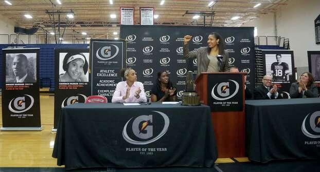 3/20/14: WNBA player, Maya Moore speaks before Manvel's Brianna Turner was  named the 2013-14 Gatorade National Girls Basketball Player of the Year. at Manvel High School in Alvin, TX.  Presenting the award was 2006-07 player of the year Maya Moore, who plays in the WNBA. and Aminah Charles from Gatorade. Photo: Thomas B. Shea, Houston Chroncile / © 2014 Thomas B. Shea
