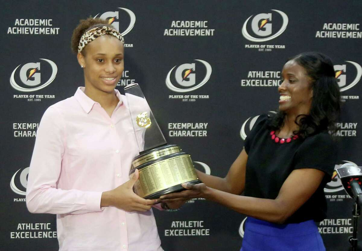 3/20/14: Aminah Charles from Gatorade presents Manvel's Brianna Turner the 2013-14 Gatorade National Girls Basketball Player of the Year. trophy at Manvel High School in Alvin, TX. Presenting the award was 2006-07 player of the year Maya Moore, who plays in the WNBA. and Aminah Charles from Gatorade.