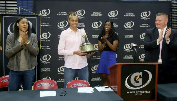 3/20/14: Aminah Charles from Gatorade presents Manvel's Brianna Turner the 2013-14 Gatorade National Girls Basketball Player of the Year. trophy at Manvel High School in Alvin, TX.  Presenting the award was 2006-07 player of the year Maya Moore, who plays in the WNBA. and Aminah Charles from Gatorade. Photo: Thomas B. Shea, Houston Chroncile / © 2014 Thomas B. Shea